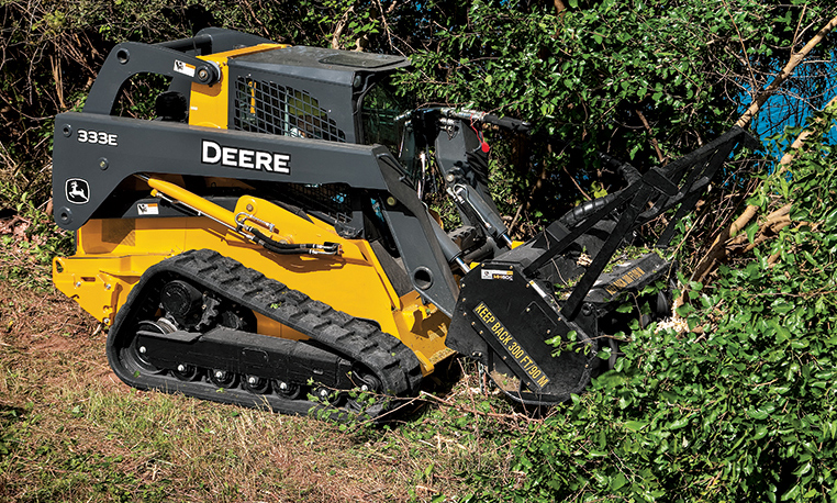 Mulching head attached to a compact track loader at work