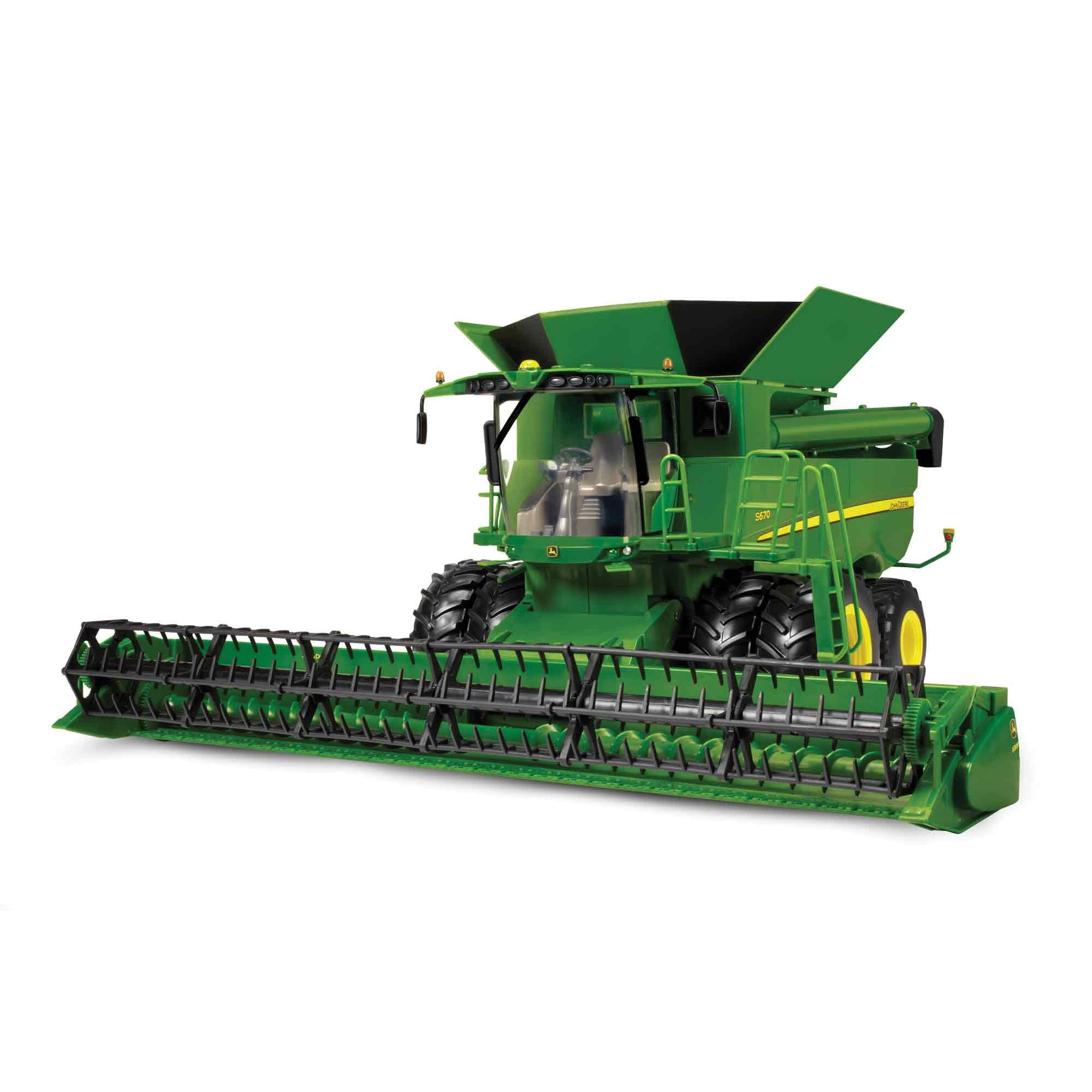 The grain head rotates when this John Deere S670 Combine is pushed ...