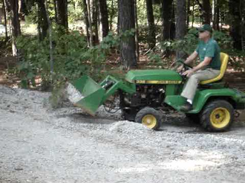 John Deere 332 with Buford Bucket Moving Gravel - YouTube