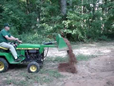 John Deere 332 With Buford Bucket Moving Dirt - YouTube