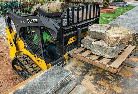 Right hand view of a 317G Compact Track Loader with a rail style ...