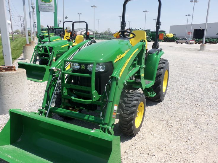 John Deere 3320 tractor with H165 loader