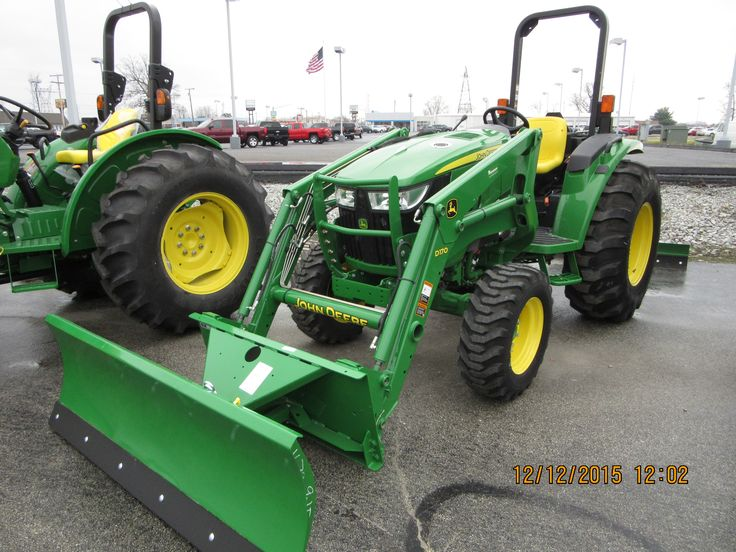 John Deere 4052M with D170 loader equipped with snowblade