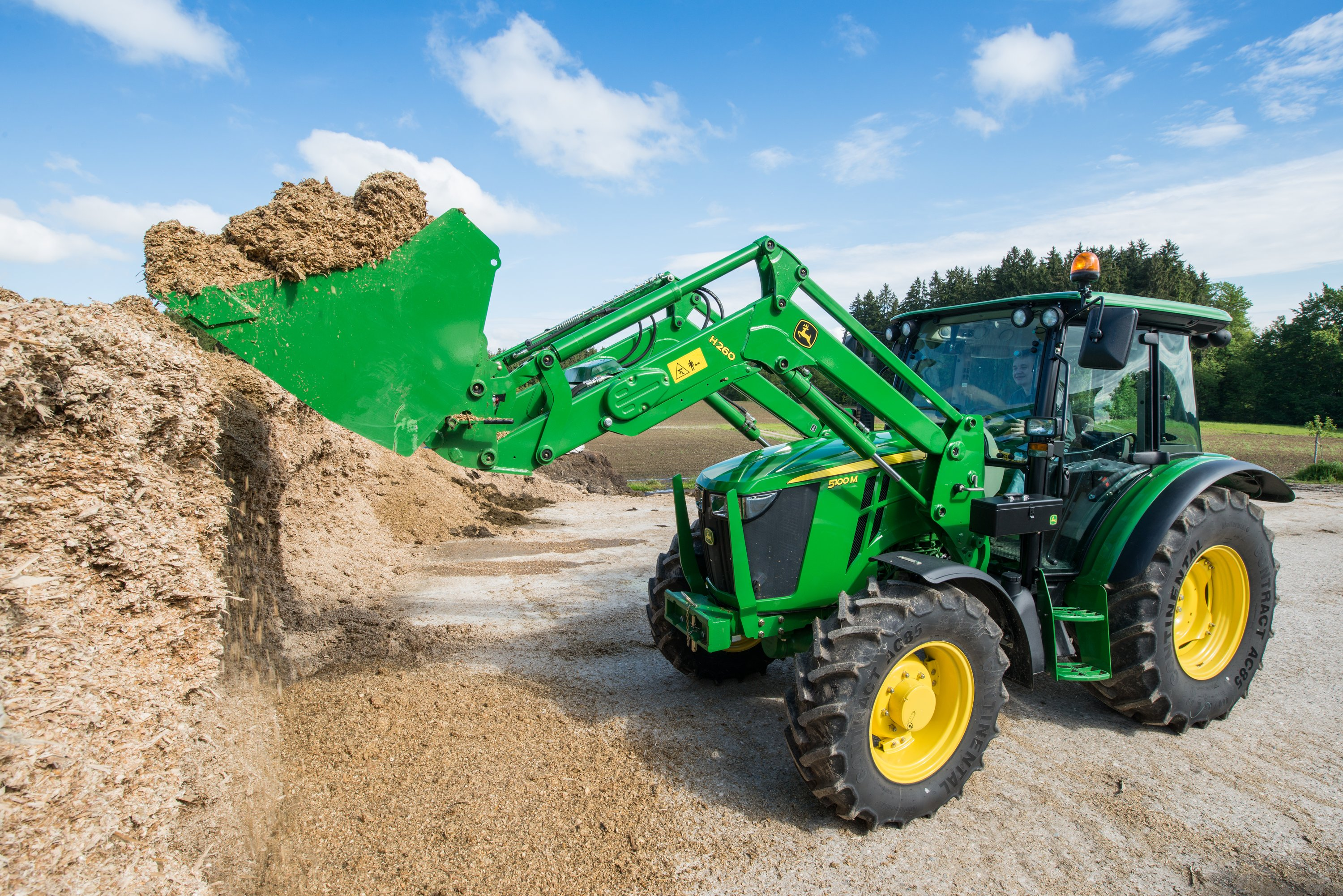 John Deere 5100M tractor with H260 front loader
