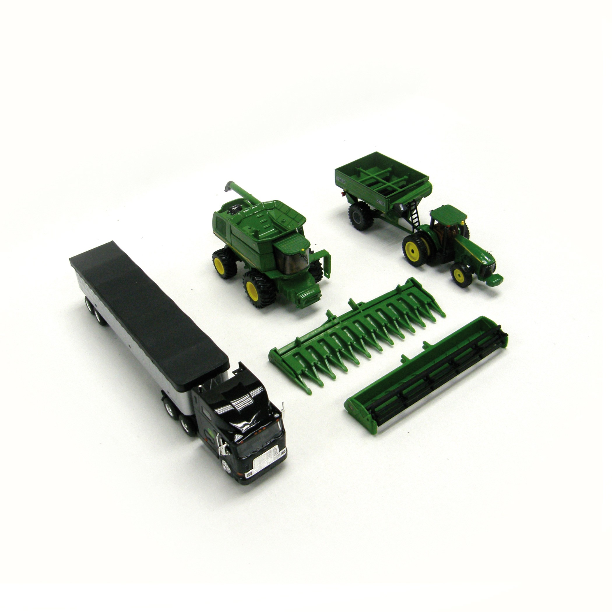 With this multiple piece 1:64 M6 John Deere Harvesting Set, your child ...